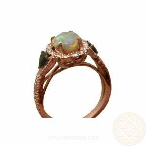 Opal ring with diamonds and tourmalines