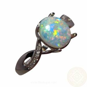 Oval opal just under one carat with 12 small quality diamonds