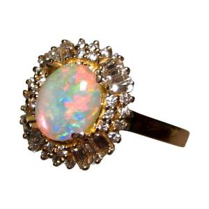 Opal ring with red and yellow oval opal