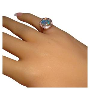 Womens opal ring with halo of 1.5 mm diamonds