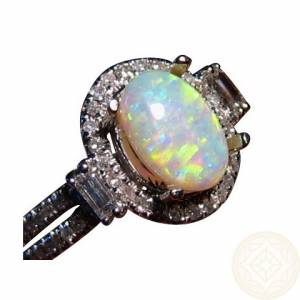 Oval white opal accented with round and baguette diamonds