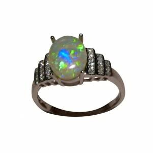 Solid 14kt gold ring with real opal stone and diamonds for sale