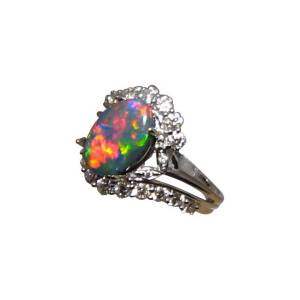 Very bright and colorful black opal ring