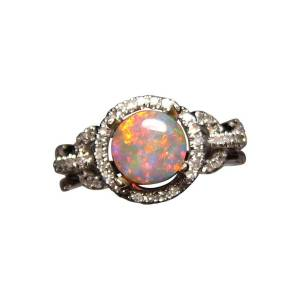 Round Lightning Ridge opal ring with diamonds