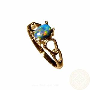 14k gold ring fancy band with an oval black opal